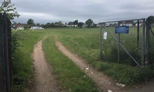 Travellers removed from playing field at a midland's school